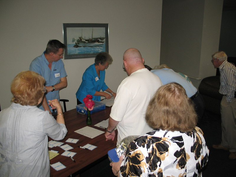 Charlotte Dexter, Tim Hartsfield and Jean Gillette greeting Former Landowner families at the registration desk inside BB-45 (Bachelor Officer Quarters), Courthouse Bay, MCB Camp Lejeune. (October 7 2012)