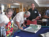 Jim Reece, with brother Thomas Reece, examine a present day Camp Lejeune Hunting/Fishing Map to get an idea of location of each area in comparison to 1941 family lands.