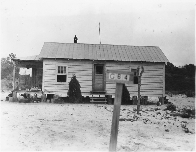 G-64 Victor Bell - House valued at $400.00.  The 37.3 acre farm appraised at $900.00 which included the house. Take note of the young 9 year old son, Hulan Bell, sitting on the left porch. He was the oldest son of Victor and Effie Rhodes Bell. He died of an accidental drowning on July 13, 1941, shortly after this photo was taken.
