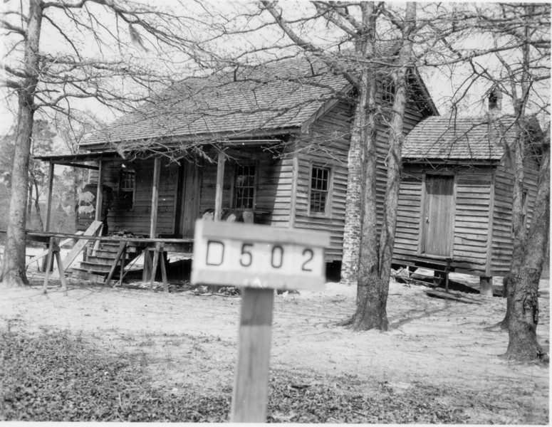 "D-502 Albert J. Ellis - Old wooden frame house in ""poor condition"" appraised for $250.00. Also included in the tract were 2 stables and 225 acres of uncleared land. The total compensation given was $1,300.00. This property was located on the Hadnot Point Road. Albert J. Ellis was an attorney in Jacksonville who was mainly responsible for an airport being built in Onslow County"