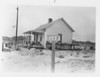 E 698 site owned by Hogan Hurst, Will Barry Hurst and Adrian Dulaney Hurst.  Shown is the ferry house next to the slip at left at Hurst and Onslow Beach Road.  Also on the site were an ice house and boat house.  The 115.7 acre site was appraised by the govt for $1,100.