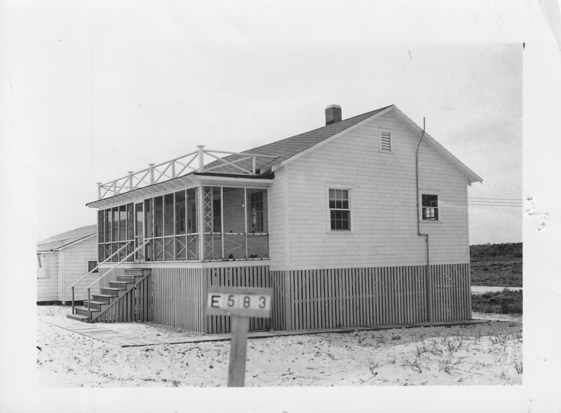 """E-583 Zeta B. Foster - This beach cottage of the Onslow Beach Development was appraised for $2,000.00. """"…house built high on piling with garage under floor.  Has 2 sets plumbing conveniences and is above average for cottage this area,"""" quote from appraisal report. Lot 25 ft. x 25 ft. Total compensation given was $2,312.00."""