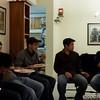 Men eating and talking