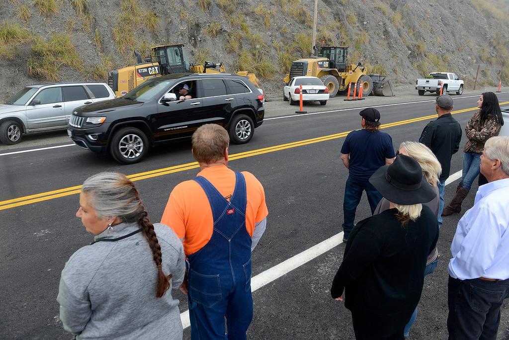 . Motorists travel north on Highway 1 over the reopened section at the Mud Creek slide south of Big Sur on Wednesday, July 18, 2018.  (Vern Fisher - Monterey Herald)