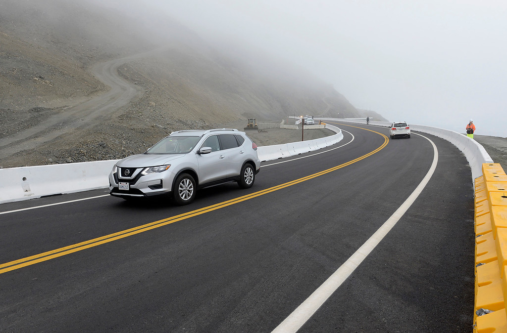. Motorists drive the new section of Highway 1 at the Mud Creek slide south of Big Sur that was reopened after more than a year of being closed on Wednesday, July 18, 2018.  (Vern Fisher - Monterey Herald)