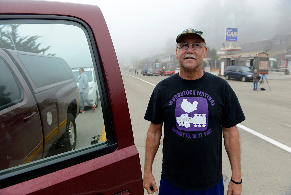 . Phil Sklar waits at the road block in Gorda for Highway 1 to reopend at the Mud Creek slide south of Big Sur on Wednesday, July 18, 2018.  (Vern Fisher - Monterey Herald)