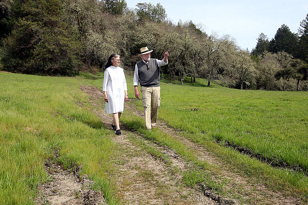 . Sister Barbara Hagel of the Dominican Sisters of Mission San Jose and Stephen Slade, Executive Director of the Land Trust of Santa Cruz County, walk along the Sisters\' Marywood retreat next to Highway 17\'s Laurel Curve where a wildlife tunnel will be built providing a safe access to the retreat\'s 173 acres.  (Dan Coyro -- Santa Cruz Sentinel)