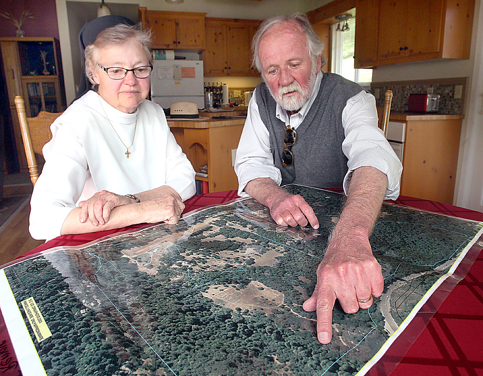 . Sister Barbara Hagel of the Dominican Sisters of Mission San Jose and Stephen Slade, Executive Director of the Land Trust of Santa Cruz County, pore over a map showing the proposed wild life tunnel beneath Highway 17\'s Laurel Curve accessing the Dominican Sisters\' 173 acres west of Highway 17.  Plans of the tunnel have been finalized and construction begins in 2020.  (Dan Coyro -- Santa Cruz Sentinel)
