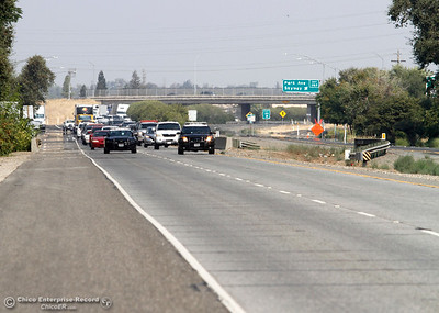 The California Highway Patrol closed Highway 99 and blocked traffic for less than 10 minutes from Skyway to Southgate Avenue in both directions for PG&E work. the utility stretched a power line across Highway 99 near Neighborhood Church on Tuesday, Aug. 21, 2018, after a power pole was damaged during a high-speed chase Monday.  (Dan Reidel -- Enterprise-Record)