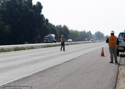 PG&E foreman Mike Neilsen, left, stretches a power line across Highway 99 near Neighborhood Church on Tuesday, Aug. 21, 2018, after a power pole was damaged during a high-speed chase Monday. The California Highway Patrol closed the highway for less than 10 minutes from Skyway to Southgate Avenue in both directions for the work. (Dan Reidel -- Enterprise-Record)