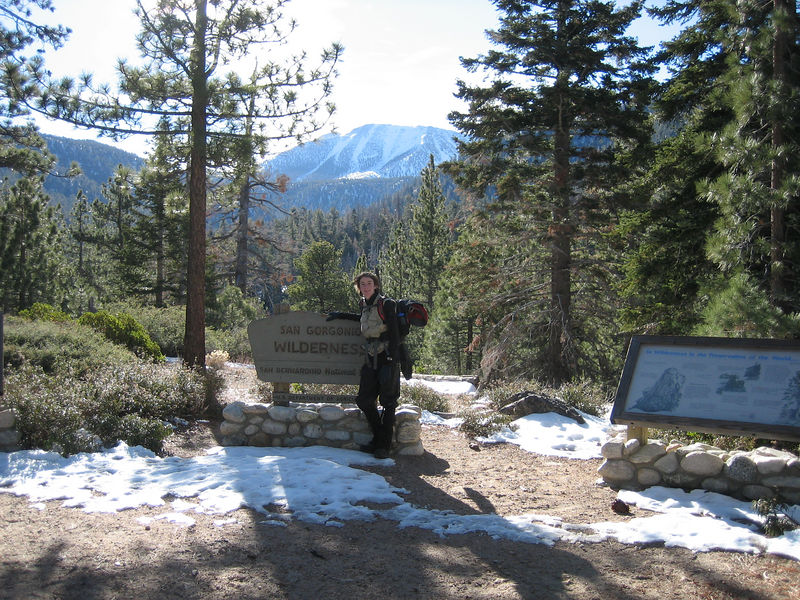 Eric strikes the obligatory pose at the Gan Gorgonio Wilderness boundary.  Mt. San Gorgonio is in the background (the summit is behind the highest visible point).