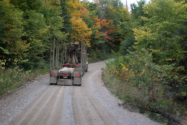 The best place to be on this road...behind a logging truck...they're a good shield against any loaded trucks coming the other direction...