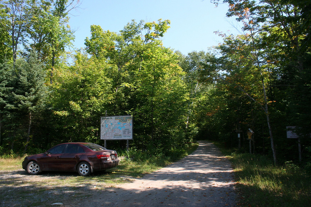 The Stokely parking area.  The signs request that you walk the 1/3 km to the lodge and trailhead...