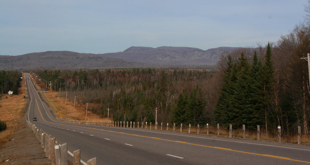 As the Trans Canada drops into the Goulais River Valley, north of the Soo, King Mountain and the Robertson Lake Cliffs rise dramatically in the distance...