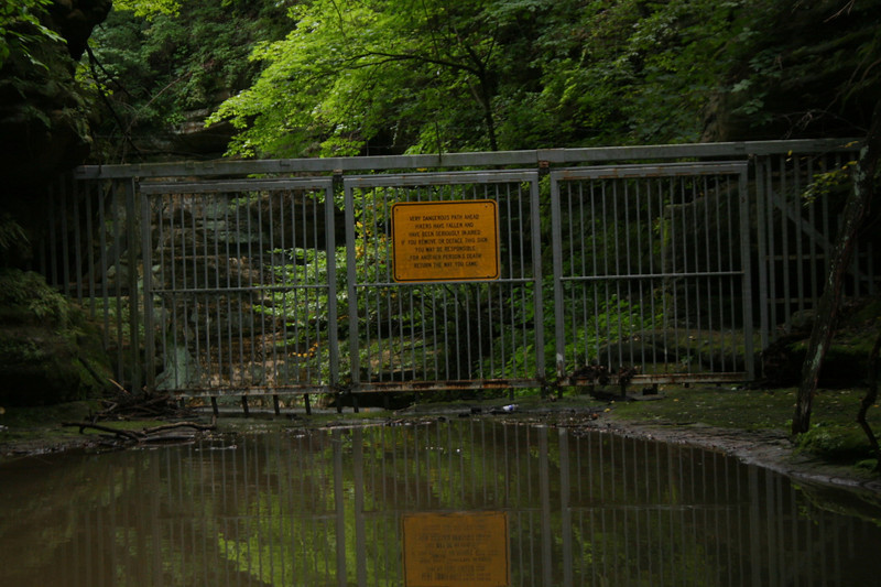 Ugly but no doubt necessary...this gate bars swimmers from making costly mistakes above Cascade Falls.  Quite a chilling warning on the sign...