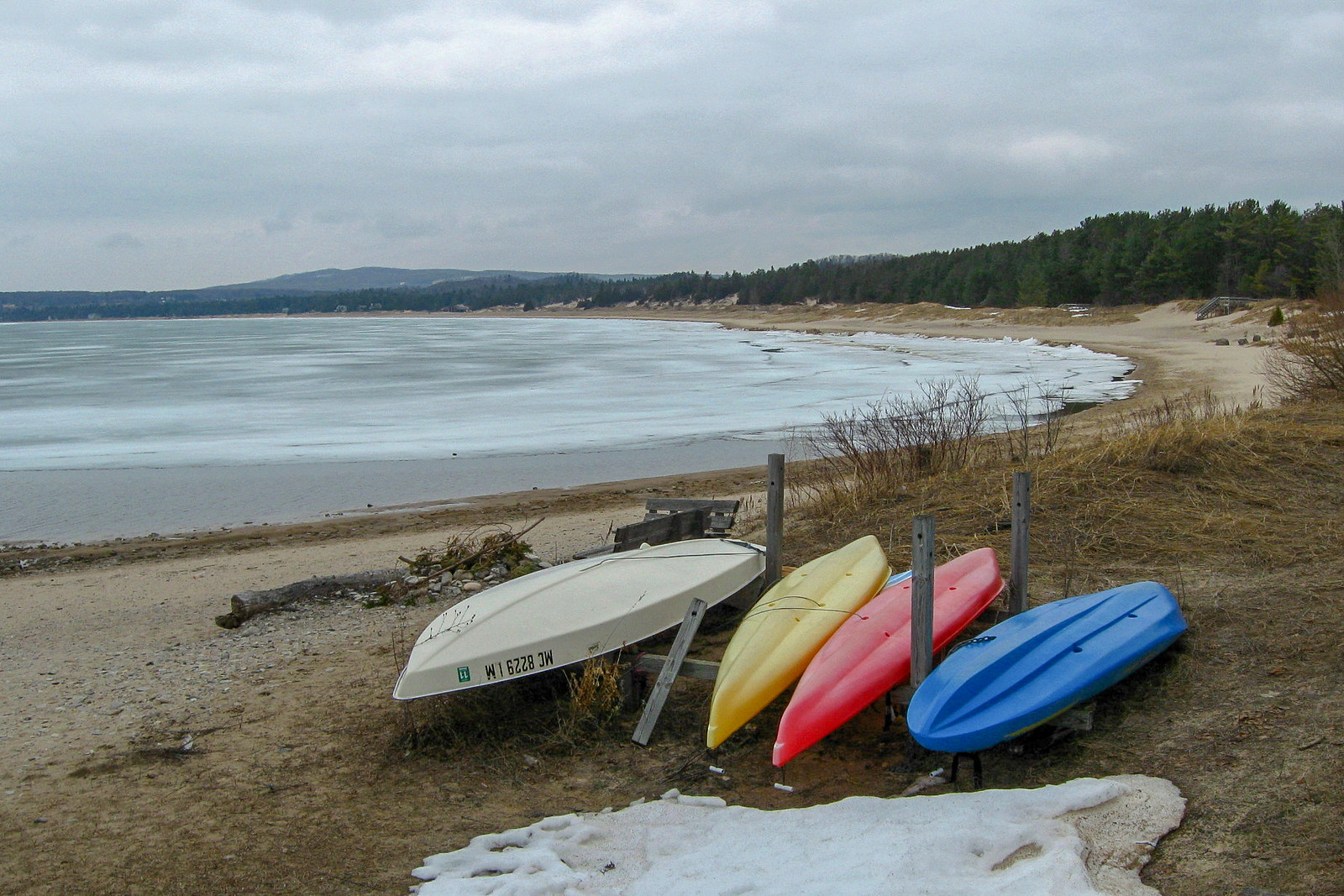 Summer fun waits patiently on the shore for the ice to clear and some sunshine...