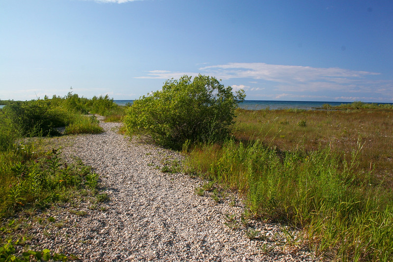 A natural gravel path leads most of the way out to the point...