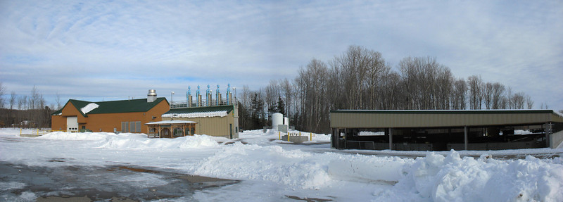 New Hatchery Grounds - After touring the breedstock building we toured the rest of the facility. From left to right is the main hatchery building, the head tanks (wells), and the uppermost raceway building.
