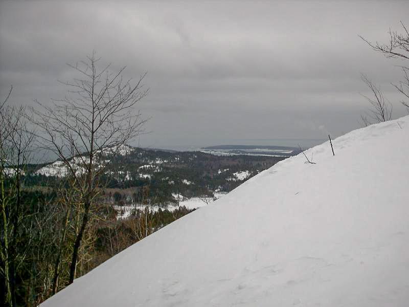 <b>Summit Snowfield</b> - Looking east to Lake Superior just below Hogback's summit.