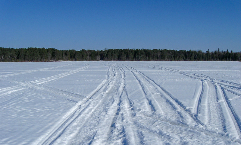 I was banking on the assumption that these fresh-ish snowmobile tracks meant the ice was still plenty strong to hold me...