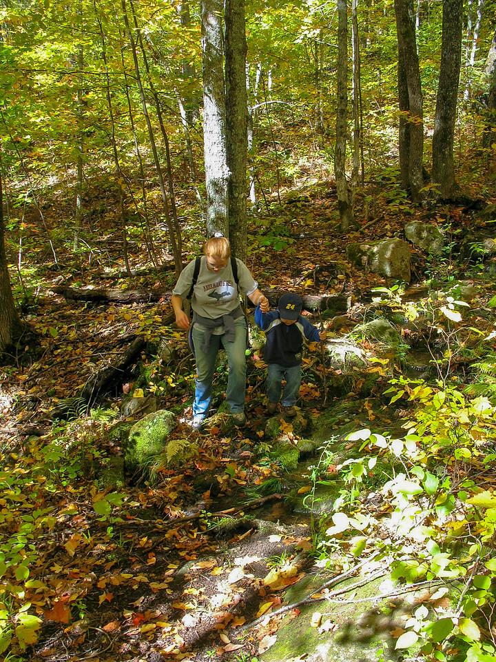 Chris helping Mom across a small stream...
