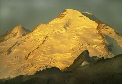 Sunrise lightens the eastern side of Mount Baker, the dormant volcano.