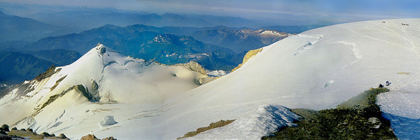 Summit of Mount Baker. Sherman Peak and snow tinted by the vents from dormant volcano left of the summit plateau. The highest point of the mountain was surprisingly free of snow.