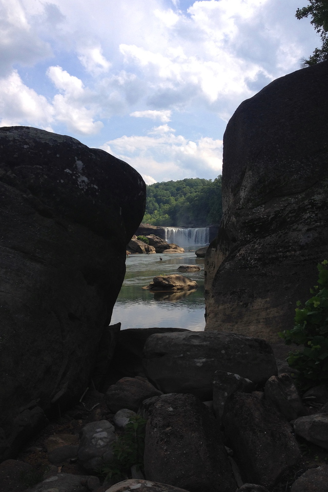 The shadows were quickly spreading as we turned back to the car.  Leaving the river, Cumberland Falls bids a fond farewell from between the rocks...