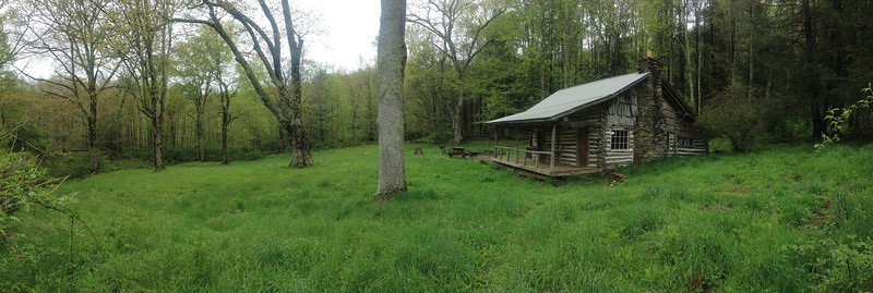 Surrounding the cabin is a huge, open field which could use a good mow...