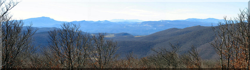 The panorama to the south from the overlook just below the summit. From left to right you can see Grandfather Mt, Sugar Mt, the Black Mountains, Beech Mt, and the Roan Mt Massif.