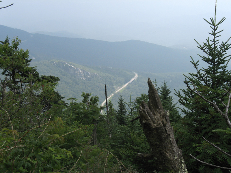 The Blue Ridge parkway winds its way around Grandfather Mountain 1000' below.
