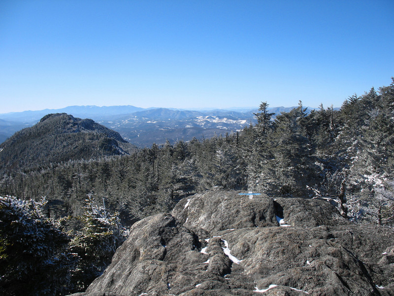 The blue blaze of the Grandfather Trail and the white blaze of the Daniel Boone Scout Trail cross at the summit of Calloway Peak. Calloway is the highest of Grandfather Mountains four main summits. Attic Window Peak is to the left, south along the ridge. - 5964'