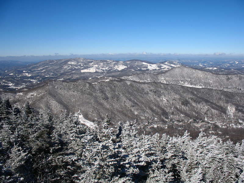 There are some wonderful views to the north and west along the summit ridge. This shot is looking west over the greater Banner Elk area. Beech Mountain, where my home was located, is the mountain in the distance with the numerous clearings.