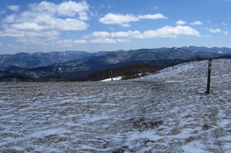 To the south from the ridge were the high peaks of Haywood County.  I believe that the broad, snow-capped summit in the center distance is Black Balsam Knob (6,214'), some 33 miles distant...