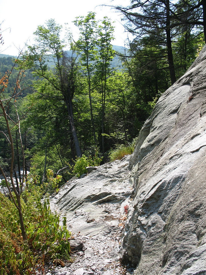 The Linville Gorge Trail makes an interesting crossing of this rock face about a mile north of the Sandy Flats Trail.