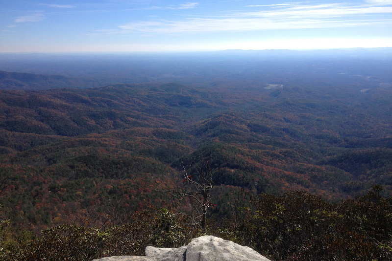 East from the summit the terrain drops off nearly 3,000 feet to the hills of the piedmont...