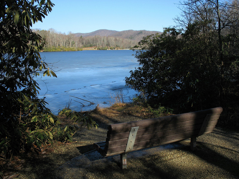 There are numerous benches like this one along the trail inviting you to take a break. Few have the view this one does though. Along the west shore.