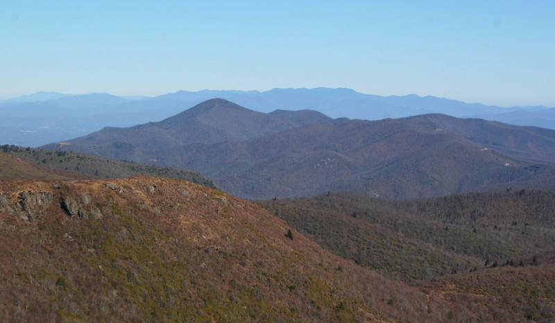 To the east is Mt. Pisgah (5,721') but what looms in the distance is what will grab your attention.  Those are the Black Mountains, the highest in the east, including Mt. Mitchell (6,684') rising above them all...