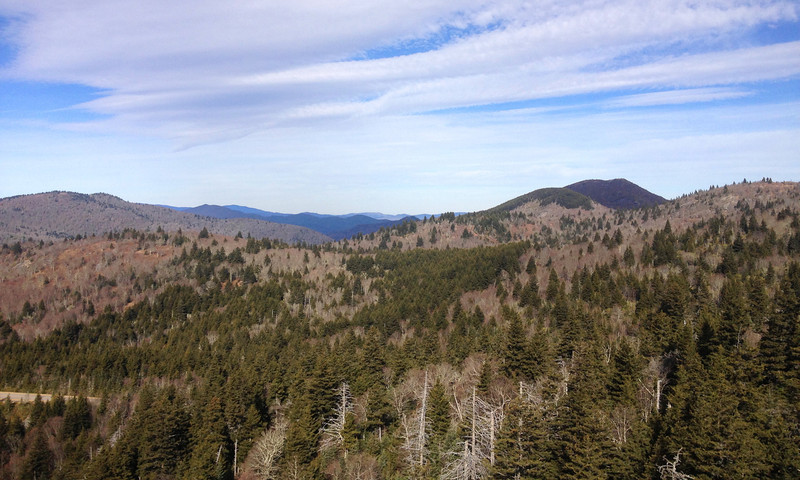 Looking north from Devils Courthouse are the ridges surrounding the Pigeon River Valley.  A cloud-shadowed Sam Knob (6,050') can be seen to the right...