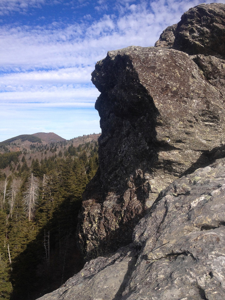The summit cliffs of Devils Courthouse with Sam Knob (6,050') in the distance...