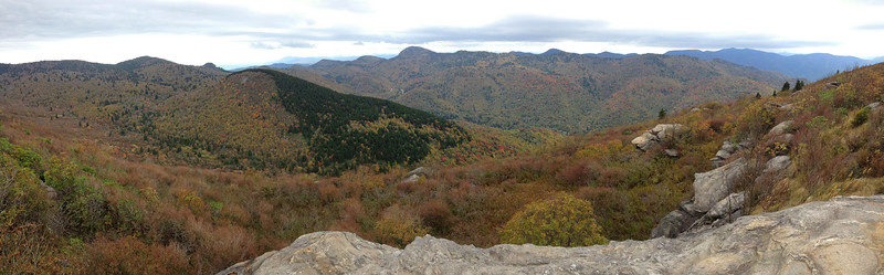 The super-panorama looking south and west from the south summit of Sam Knob (6,050').  To the left is the upper Flat Laurel Creek Valley with Little Sam Knob (5,862') and the tiny nub of Devils Courthouse (5,670') rising above it.  Center is Mt. Hardy (6,110') again, while the darkened mountain range to the distant right is the Plott Balsams and their high peak of Richland Balsam (6,410')...
