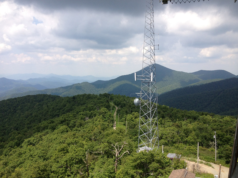 The communication towers disrupt the view to the east a bit...on a clearer day the Black Mountain Range, including Mt. Mitchell would be visible in the far distance beyond Mt. Pisgah...