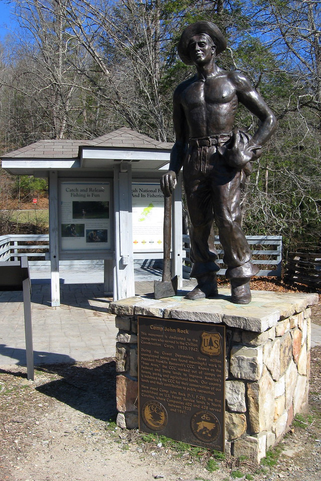 A monument to Camp John Rock, the first CCC camp in North Carolina, stands alongside the parking area...
