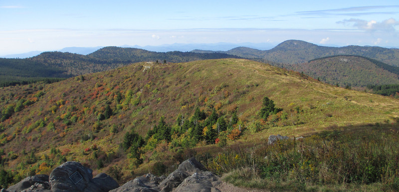 Black Balsam Knob summit, looking south and west with Chestnut Bald (6,040') and Mt. Hardy (6,110') visible in the distance...  (6,214')