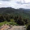 Mt. Gibbes, Mt. Hallback, Mt. Mitchell, & Mt. Craig, NC (6-4-14) : It had been over a year since I had added any peaks to my SB6K list...time flies when you're having fun I guess.  To kick off what I hope to be a rather productive summer of 6-er's I decided to head over to the crown of the Appalachians, the Black Mountain Range.  My goal for this day would be to knock off four peaks along the southern end of the range...Mount Gibbes (6,571'), Mount Hallback (6,391'), Mount Craig (6,648'), and the big guy Mount Mitchell (6,684').    The 9-miles required to hit all these peaks is, all things considered, pretty straight forward despite two of the peaks involving bushwhacks.  Starting at Steppes Gap, I'd make the loop south to Mt. Gibbes (which involves an optional downhill bushwhack).  I'd then head north via the Old Mitchell Trail, making the short bushwhack up to Hallback before continuing on good trail to the summit of Mitchell.  I wasn't originally planning on including Mt. Craig on this hike but it was such a nice day and I was feeling pretty good so I figured why not do a bonus peak?!  From the Mt. Mitchell summit parking lot its only a 2-mile out and back to Craig which, in my opinion, is not a lot of effort for what your rewarded with at its summit!  I'd then backtrack as far as the Camp Alice Trail at which point I'd drop down to the Commissary Trail for the hike out.  With the exception of a couple very short stretches, this entire hike stays above the 6,000-foot contour for its entirety...a perfect escape when temps in the valley's start to get uncomfortable.  That and, despite a chance of rain in the forecast, I stayed dry and enjoyed more than a little sun and blue sky on the way.  Come on along as I knock off #18, 19, 20, and 21...passing the halfway mark on my South Beyond 6000 quest...  Mileage Hiked:  9.0 miles Trailhead Temp:  60'F Min. Elevation:  5,770' Max Elevation:  6,684'