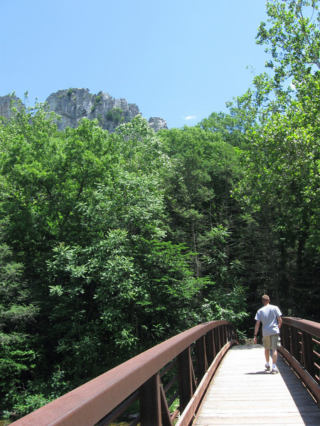 The cliffs rise above the trees at the second river crossing...