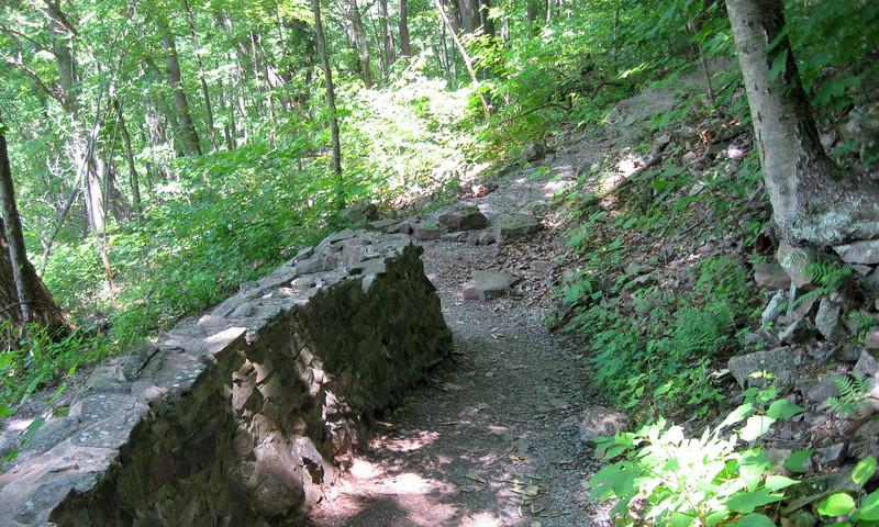 How do you prevent people from cutting across switchbacks? Build a big 'ol wall, of course!!