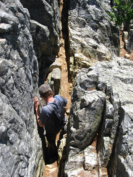 To get out to the cliff edge we had to descend this narrow crack...