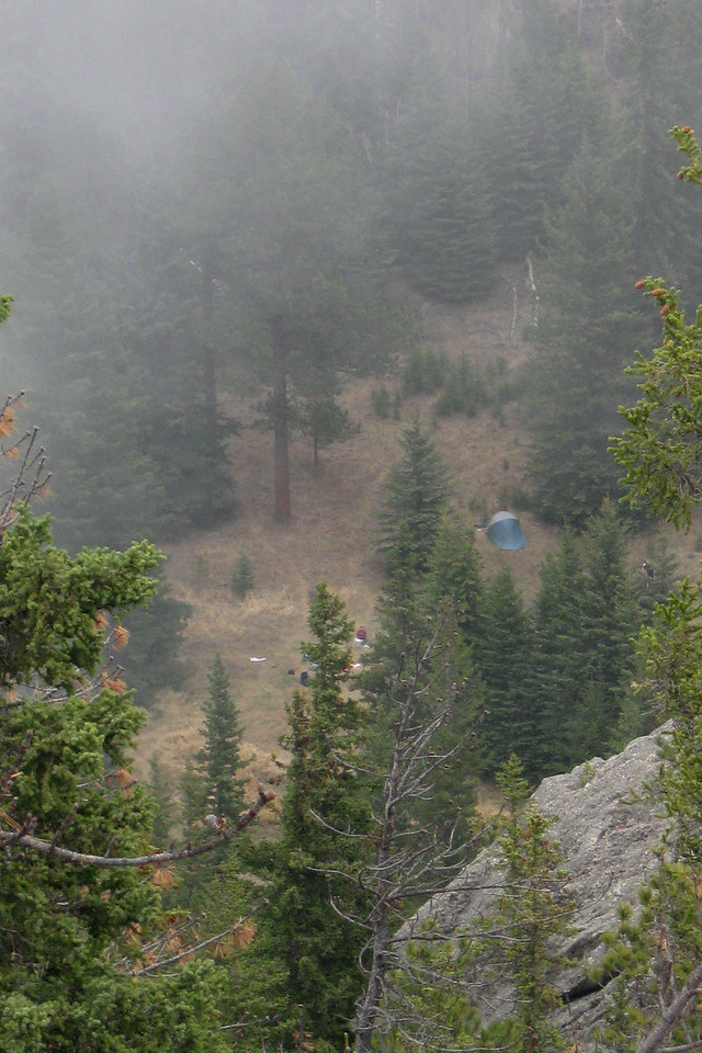 A zoomed shot of camp from the uppermost cliffs pictured on page one...