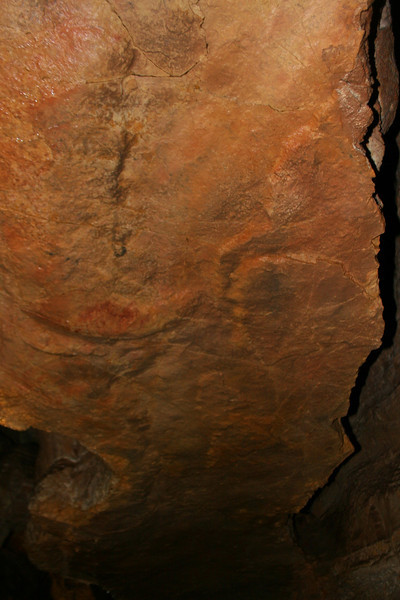 This low hanging, flat ceiling is called a 'chert layer'...the smooth rock below is eroding slower than the softer rock it is hanging from...if I had known this at the time I wouldn't have hung around under it quite so long!